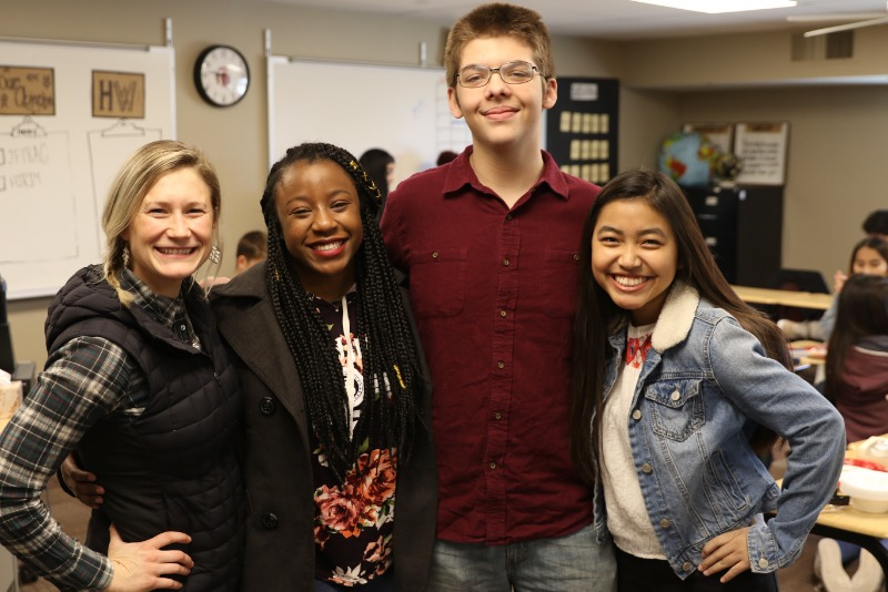 Jordan Johnson (left), AVID teacher at Jenks High School, shares a smile with her students, Sh'eaven Miles, Daniel Evans, and Nuami Lam Tung.