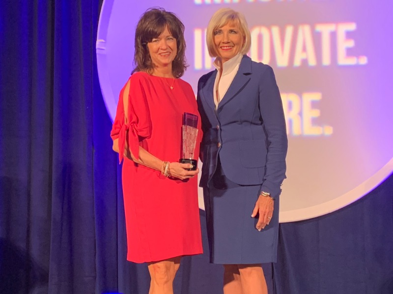 Dr. Stacey Butterfield receives the Oklahoma Superintendent of the Year Award from Pam Deering, Executive Director of the Cooperative Council for Oklahoma School Administrators (CCOSA) at the annual Summer Leadership Conference in Norman on Wednesday, Jun
